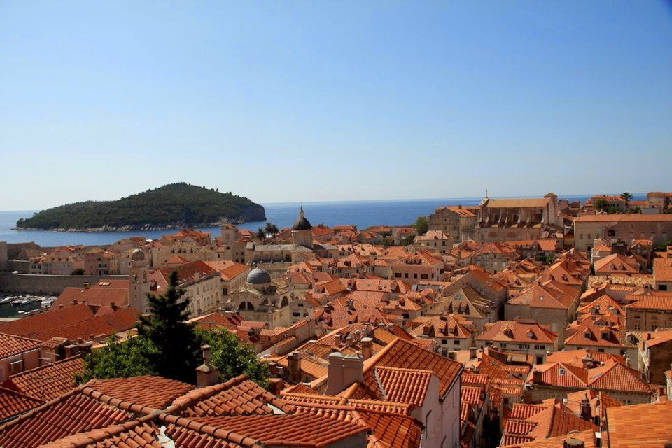Dubrovnik: Red tiled roofs with Lokrum Island in the background