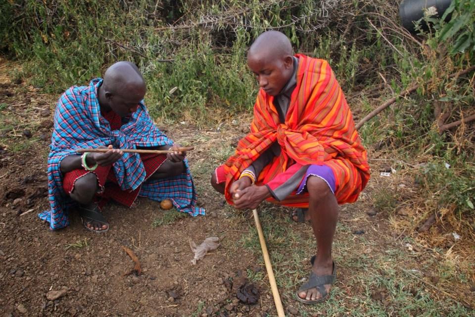 Masais making fire without a matchstick