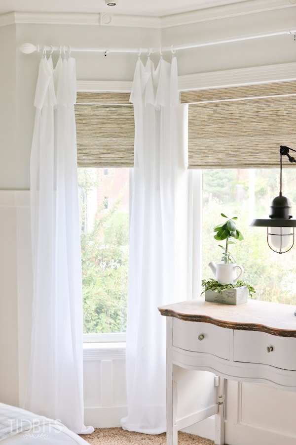 Affordable textured jute-like roller shades - as seen in TIDBITS master bedroom reveal.