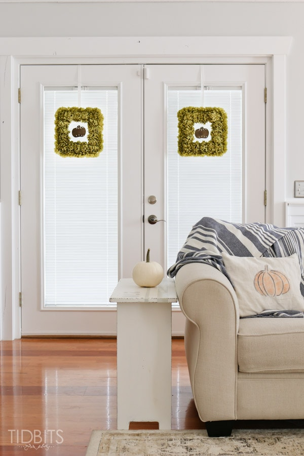 DIY Fall Floral Wreath made from styrofoam and artificial mums.