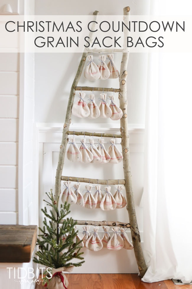 Christmas Countdown grain sack bags hanging on a log ladder. Pattern and tutorial available - by TIDBITS.