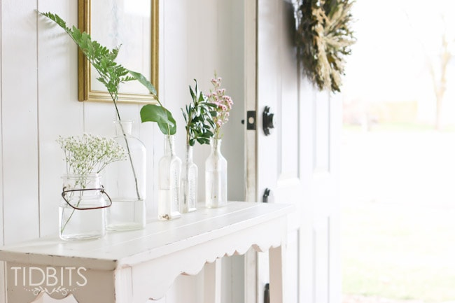 Spring Home Tour by TIDBITS - Freshen up an entry way with free or on a dime greenery placed inside jars.