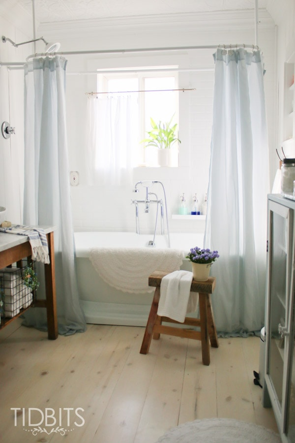 How to make a store bought window curtain work as a shower curtain.
