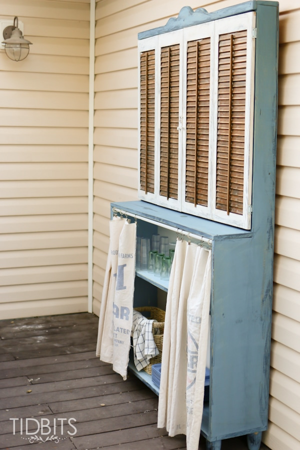 Antique hutch and TV storage.  Deck makeover by TIDBITS.