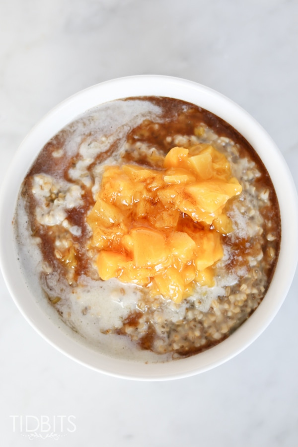 Pressure cooker or slow cooker peaches and cream steel cut oats, with a cinnamon maple drizzle.