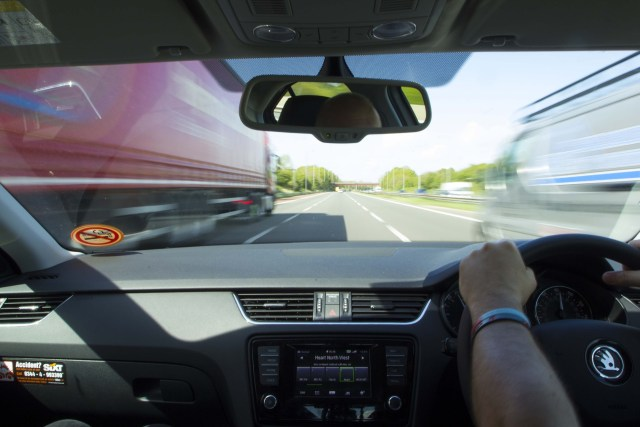 picture of drivers view when driving down the motorway between two lorries