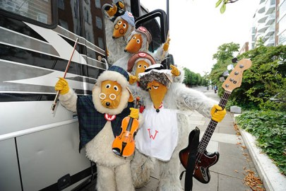 The Wombles with their tour bus