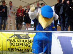 Haydon the Womble waves to the crowd