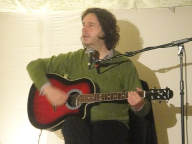 Julian Butler plays guitar