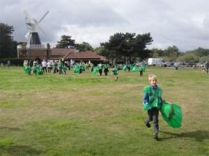 The children run to start litterpicking