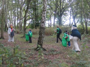 Orinoco and Great Uncle Bulgaria look for litter in the woods
