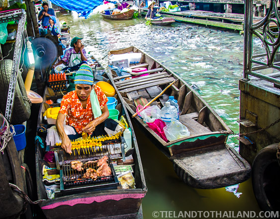 Taling Chan Floating Market Grilling Meat on a Boat