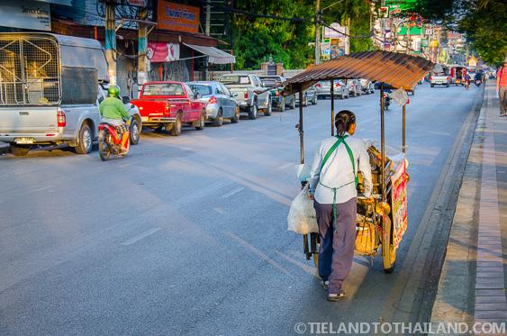 Thai Woman Pushing Her Food Cart