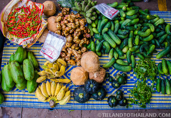 Fresh Thai Fruits and Vegetables For Sale on a Rattan Mat