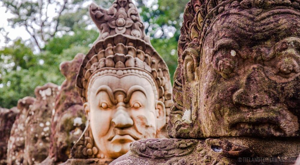 Walk pass these statues on your one or three day itinerary to Angkor