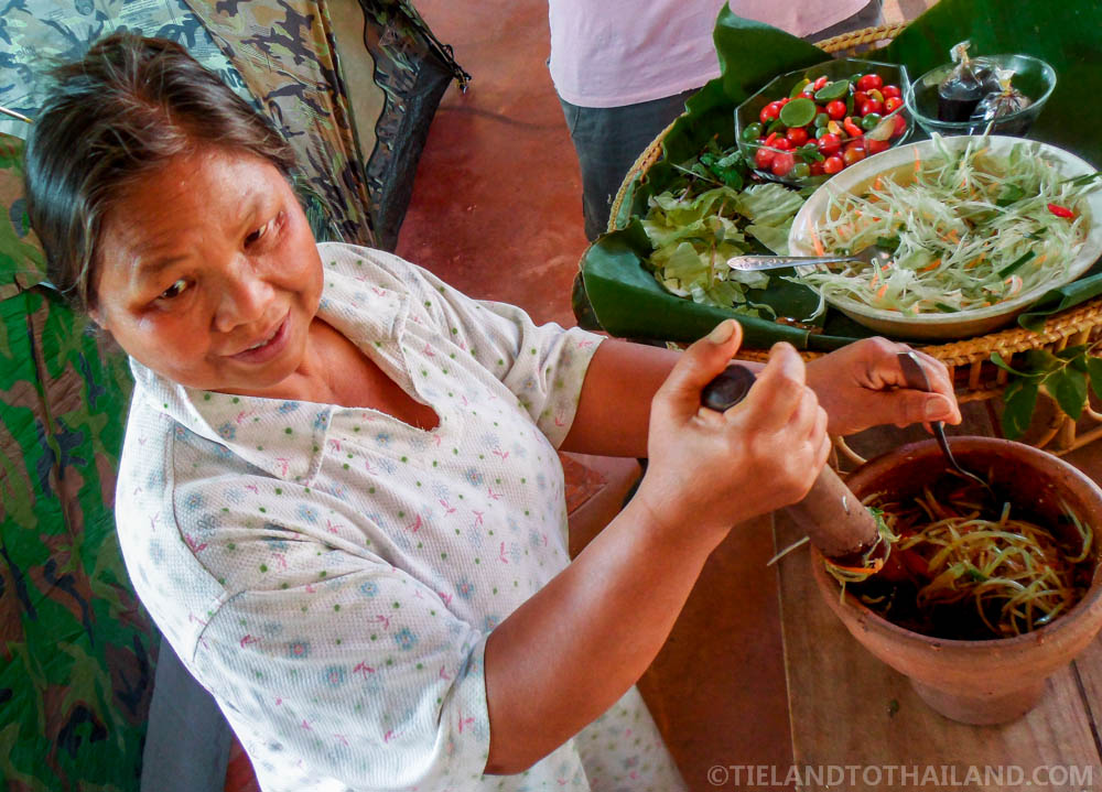 Woman making papaya salad in Isaan
