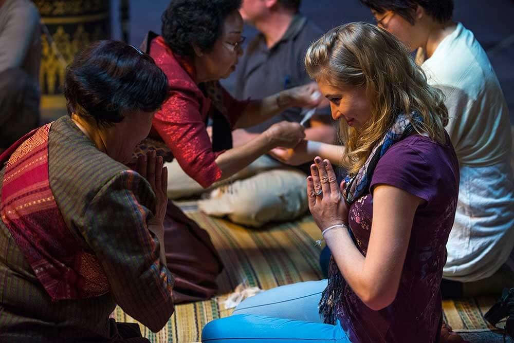 Blessing at Wat Si Khun Muang in Chiang Khan, Loei