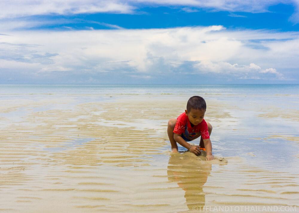 Thai boy playing at White Sands Beach, Koh Chang