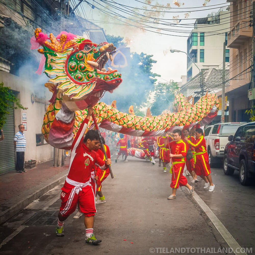 Mythical dragons parading down the streets of the Bangkok Vegetarian Festival