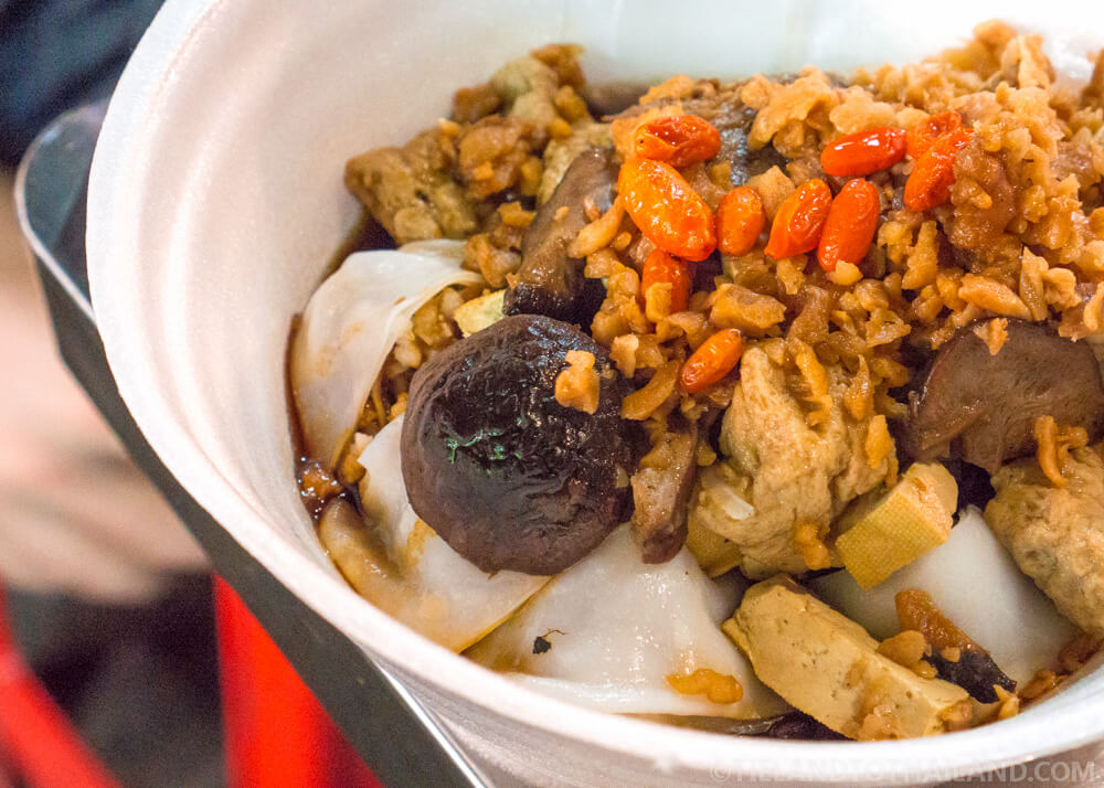 Mushrooms, tofu, and wide rice noodles serve up at the Bangkok Vegetarian Festival