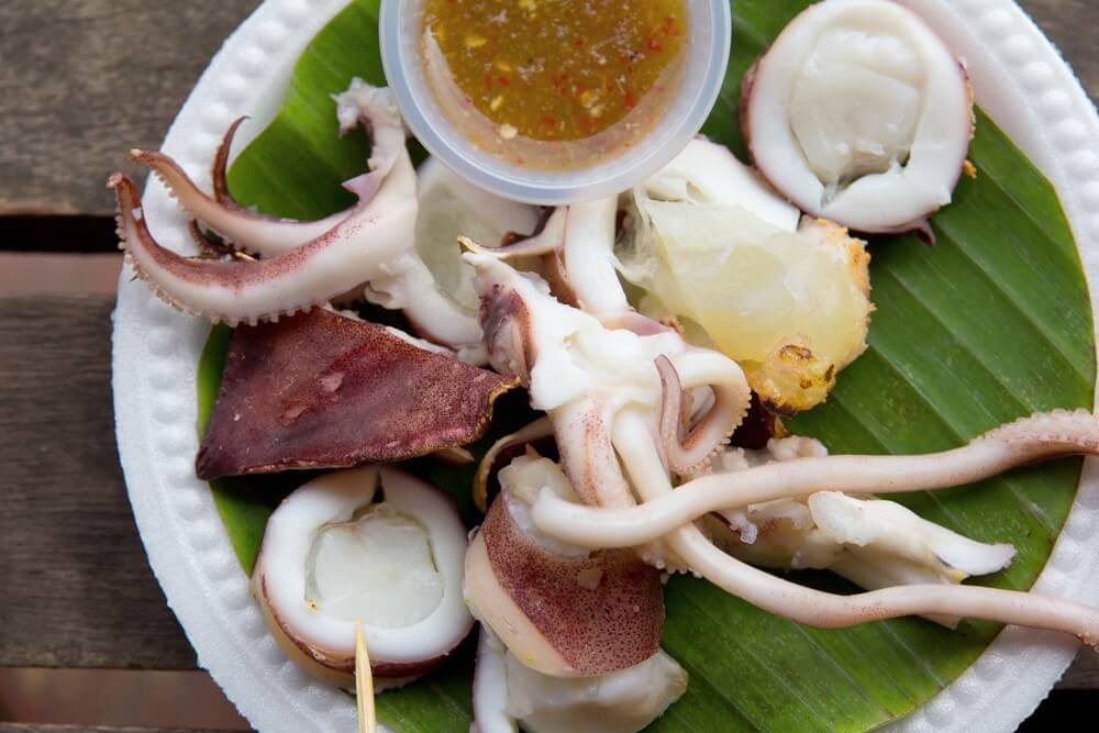 Grilled Squid with Green Chili Sauce - Pla Muek Yang Nam Chim | Food Guide to Thai Street Snacks