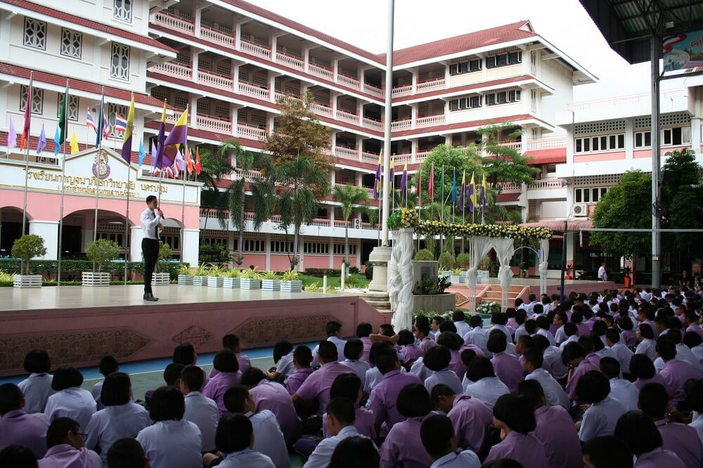 Students attend an assembly at a Sine Education school