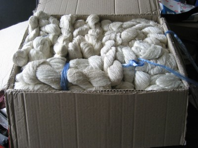 A big box full of hand-reeled silk from Laos