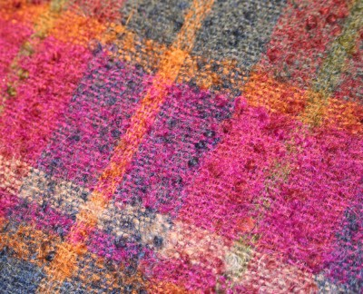 The backside of the brushed mohair fabric, showing the boucle yarn used to weave it.  Click on it to get the  closeup version.