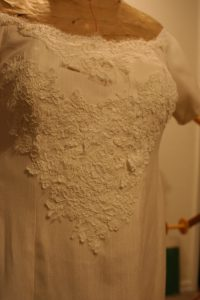 handwoven wedding dress with basted-on Alencon lace, close up