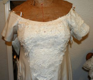 Handwoven wedding dress, with lace on one sleeve