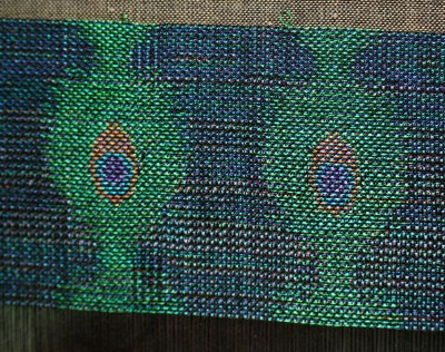handwoven peacock feather design, in five-weft taquete
