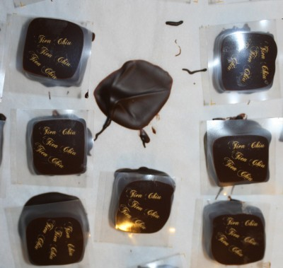 "Strawberry-balsamic vinegar bonbons, ""printed"" with my name via custom-made acetate transfer sheets"
