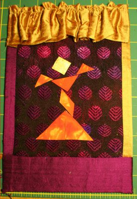 Front cover of book (handwoven fabric in background)