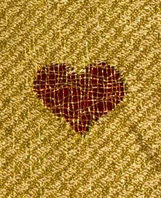 Devore hearts, metallic nylon against a red velvet background