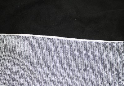 jacket fabric with leather and simulated white piping