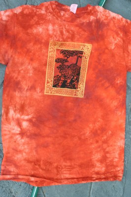 bordered tiger print on rust-colored fabric