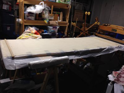 five feet of warp woven with sacrificial weft and then stretched out on the table