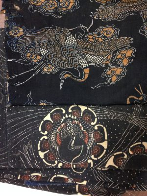 Two pigment-dyed fabrics. The bottom one is nearly new and shows harsh coloring using rust pigments. The top has been washed multiple times, washing away the dark rust areas and leaving a much softer, more appealing look.