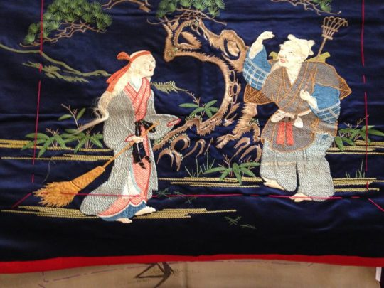 an exquisite piece of embroidery. Th woman's hair is left free at the ends!