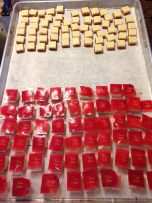 passionfruit caramels with white chocolate ginger rum ganache, being dipped