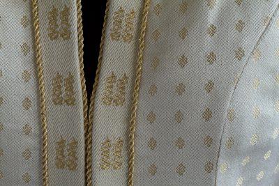 close-up of Tien's handwoven wedding coat