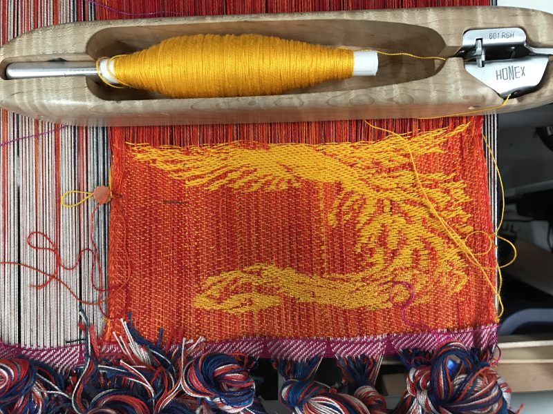 Red warp, golden yellow weft for handwoven phoenix and dragon scarf