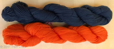 orange and dark blue yarns together
