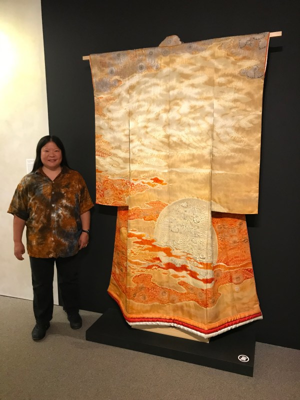 Tien with Itchiku Kubota's Burning Sun, at the Textile Museum of Canada