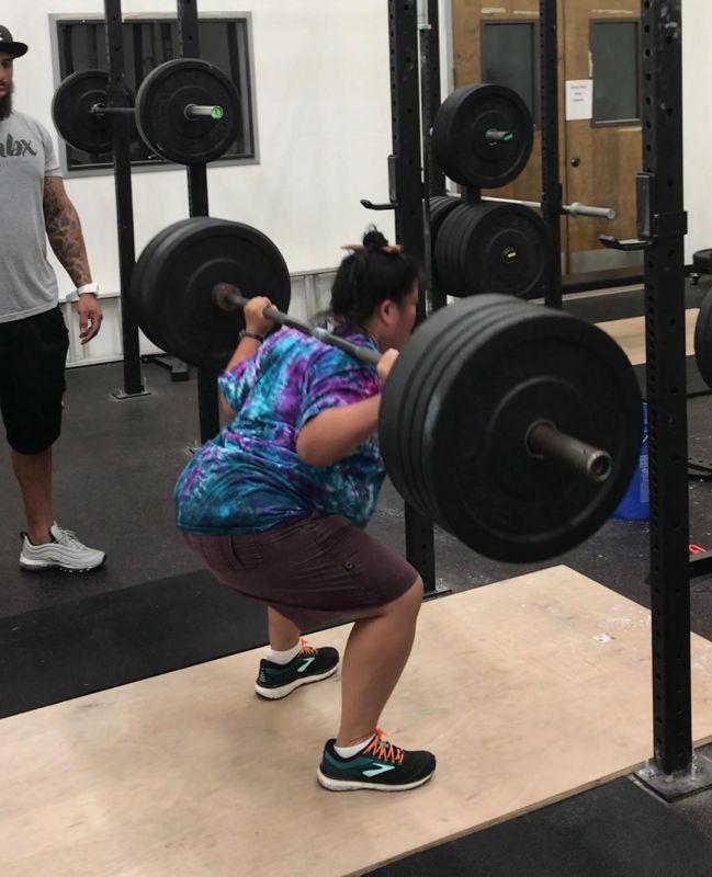 Tien squatting 195 pounds