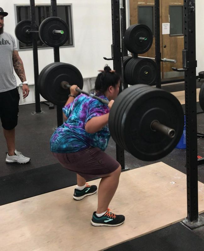 Tien squatting 195 pounds