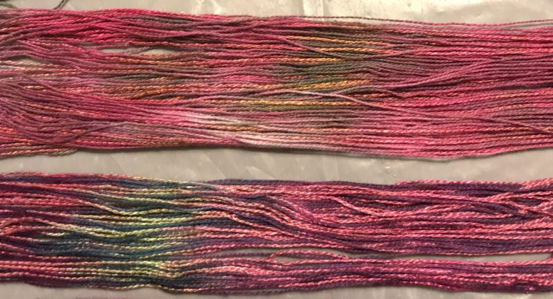 two fuchsia-and-green skeins, dyed differently