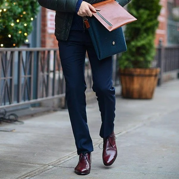 man wearing red dress shoes