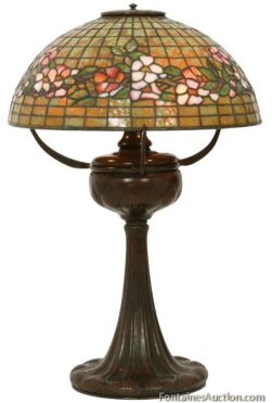 A wonderful example of one of Tiffany Studio's original Tiffany lamps is this Tiffany Studio's Banded Dogwood, Table Lamp Price Realized at Fontaine's Auction: $36,300.00