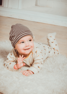 Picture of baby smiling and waving.